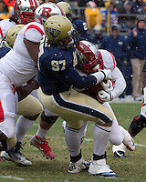 Pitt defensive tackle Aaron Donald (97) brings down a Rutgers running back. The Pitt Panthers defeat the Rutgers Scarlet Knights 27-6 on Saturday, November 24, 2012 at Heinz Field , Pittsburgh, PA.