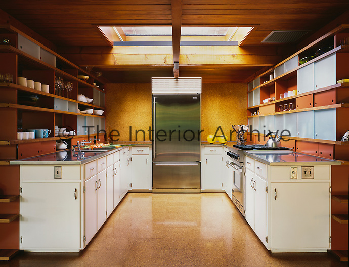 A retro style kitchen with skylight and a cork floor