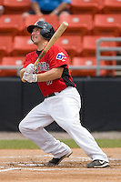 Mike Hollander #17 of the Hickory Crawdads follows through on his swing versus the West Virginia Power at L.P. Frans Stadium June 21, 2009 in Hickory, North Carolina. (Photo by Brian Westerholt / Four Seam Images)