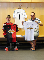 Pictured: A lucky Swansea City FC supporter was the first to have a look at the new kt. Saturday 21 June 2014<br /> Re: Launch of the new home and away kit for Swansea City Football Club at the Liberty Stadium, south Wales.
