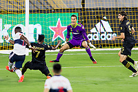 LOS ANGELES, CA - SEPTEMBER 23: Pablo Sisniega #23 GK of LAFC defending against a shot from Janio Bikel #19 of the Vancouver Whitecaps during a game between Vancouver Whitecaps and Los Angeles FC at Banc of California Stadium on September 23, 2020 in Los Angeles, California.