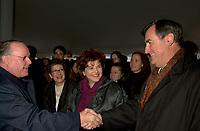 Montreal, Dec 3rd, 2001<br /> <br /> Quebec Premier Bernard Landry (L), shake hands with previous Quebec Premier ; Lucien Bouchard (R) while Quebec State Minister for Culture and Communications ; Diane Lemieux M) smiles,<br /> at the official launch of the new Quebec Library's (Grande Bibliothcque du Qu»bec  )construction on Berri street in Montreal, CANADA, Monday december 3rd, 2001.<br /> <br /> (Photo by Pierre Roussel - Images Distribution)