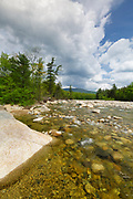 East Branch of the Pemigewasset River in Lincoln, New Hampshire on a cloudy spring day. This river begins deep in the Pemigewasset Wilderness in the area known as Stillwater Junction.