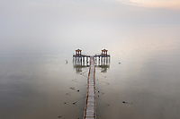A deserted pavilion extends out into Bohai Bay near the town go Ninghe, in eastern Tianjin. This stretch of coastline has been identified as being particularly vulnerable to coastal erosion on will increasingly be threatened as sea levels rise and storm surges increase. 2019