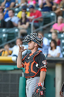 Max Stassi (12) of the Fresno Grizzlies gives the signal to the infielders during the game against the Salt Lake Bees in Pacific Coast League action at Smith's Ballpark on June 13, 2015 in Salt Lake City, Utah.  (Stephen Smith/Four Seam Images)