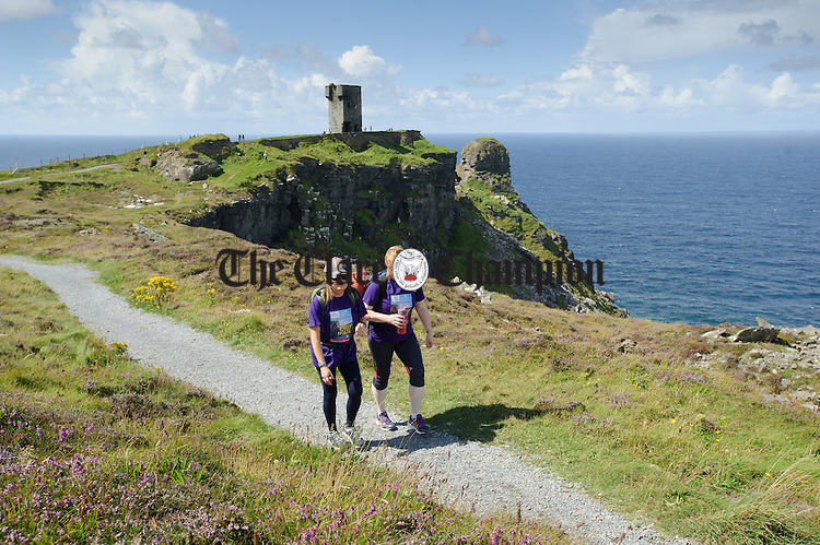 Helen O Brien and Mairead Whelan leave Hags Head behind during the Weightwatchers/Clare Champion Liscannor to Cliffs of Moher coastal walk. Photograph by John Kelly.