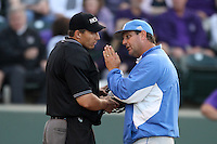 UCLA Bruins Head Coach John Savage #22 argues with home plate umpire Mark Uyl during a game against the TCU Horned Frogs at the Los Angeles super regionals at Jackie Robinson Stadium on June 9, 2012 in Los Angeles,California. UCLA defeated TCU 4-1.(Larry Goren/Four Seam Images)