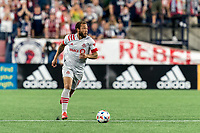 FOXBOROUGH, MA - JULY 7: Nick DeLeon #18 of Toronto FC brings the ball forward during a game between Toronto FC and New England Revolution at Gillette Stadium on July 7, 2021 in Foxborough, Massachusetts.