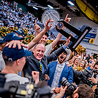 16 March 2019: University of Vermont Catamount Head Coach John Becker holds the 2019 Denis E. Lambert Trophy to celebrate a victory against the UMBC Retrievers in the America East Championship Game at Patrick Gymnasium in Burlington, Vermont. The Catamounts defeated the Retrievers 66-49, avenging their loss against the same team in last years' Championship Game. Mandatory Credit: Ed Wolfstein Photo *** RAW (NEF) Image File Available ***