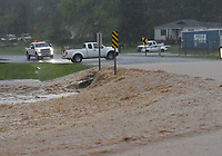A motorist stops and turns around to avoid  on Wednesday April 28 2021 a flooded section of Arkansas 12 in the Prairie Creek community east of Rogers. Go to nwaonline.com/210429Daily/ to see more photos.<br />