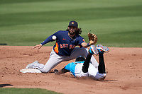 Houston Astros second baseman C.J. Hinojosa (60) fields a throw as Lewis Brinson (25) slides in during a Major League Spring Training game against the Miami Marlins on March 21, 2021 at Roger Dean Stadium in Jupiter, Florida.  (Mike Janes/Four Seam Images)