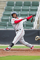 Wendell Rijo (11) of the Greenville Drive follows through on his swing against the Kannapolis Intimidators at CMC-Northeast Stadium on April 6, 2014 in Kannapolis, North Carolina.  The Intimidators defeated the Drive 8-5.  (Brian Westerholt/Four Seam Images)
