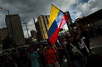 Students of the Universidad Nacional de Colombia, carrying the Colombian flag, take part in a protest march against government's policies and corruption within the public educational system in Bogotá, Colombia, 24 October 2019.