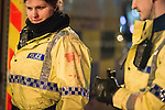 """© Joel Goodman - 07973 332324 . NO SYNDICATION PERMITTED . 20/12/2014 . Manchester , UK . Police with bloodstained uniforms . The officers had tended to a man with a head injury outside Deansgate Locks nightclub venue . The ambulance took over 40 minutes to arrive . """" Mad Friday """" revellers out in the rain and cold in Manchester . Mad Friday is typically the busiest day of the year for emergency services , taking place on the last Friday before Christmas when office Christmas parties and Christmas revellers enjoy a night out .  Photo credit : Joel Goodman"""