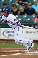 Round Rock Express outfielder Leonys Martin #27 attempts to bunt during the Pacific Coast League baseball game against the Las Vegas 51s on August 7th, 2012 at the Dell Diamond in Round Rock, Texas. The Express defeated the 51s 5-4. (Andrew Woolley/Four Seam Images).