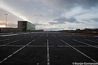 One of the first buildings you see, when driving from Keflavik international airport to the greater Reykjavik area, is this office building in Hafnarfjordur. Newly raised and empty.