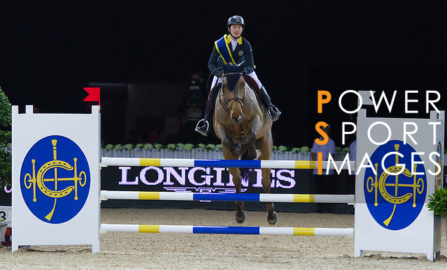 Jacqueline Lai during jump over the HKJC fence the HKJC Race of the Rider during the Longines Masters of Hong Kong on 19 February 2016 at the Asia World Expo in Hong Kong, China. Photo by Juan Manuel Serrano / Power Sport Images