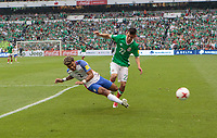Mexico City, Mexico - Sunday June 11, 2017: DeAndre Yedlin, Hirving Lozano during a 2018 FIFA World Cup Qualifying Final Round match with both men's national teams of the United States (USA) and Mexico (MEX) playing to a 1-1 draw at Azteca Stadium.