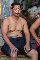 Bali, Indonesia.  Man Awaiting Beginning of  Kecak Dance, Arena adjacent to Uluwatu Temple.