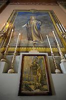 San Basilide, protettore della polizia peniterziaria..La chiesa di San Gaudenzio è stata completamente ristrutturata ed affrescata nel 1942, da un detenuto della colonia penale..Pianosa Island. The church of San Gaudenzio..