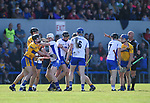 Clare and Waterford players exchange views  during their National League game at Cusack Park. Photograph by John Kelly.