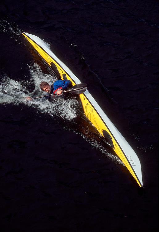Sea kayaker Nigel Foster practices a low brace turn, viewed from above, single sea kayak type: Legend, Nigel Foster Designs