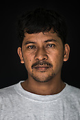 34 year old Tuna fisherman, Raygean Ompad poses for a portrait at the Casa, the Tuna buying house in Puerto Princesa, Palawan in the Philippines. <br /> Photo: Sanjit Das/Panos for Greenpeace