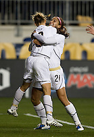 Alex Morgan (21) of the USWNT celebrates her goal with teammate Kristine Lilly (13) during an international friendly at PPL Park in Chester, PA.  The U.S. tied China, 1-1.