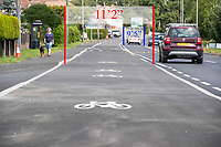 """BNPS.co.uk (01202) 558833. <br /> Pic: CorinMesser/BNPS<br /> <br /> Pictured: The cycle lane, which 11'2"""" inches wide, and the road, one lane of which is only 9'5"""" wide. <br /> <br /> A cycle lane which is believed to be one of Britain's widest has been slammed by road users who are bemused by its size.<br /> <br /> Despite measuring over half as wide as the adjacent road, cyclists have still been spotted using the carriageway instead of the cycle lane.<br /> <br /> The cycle way is a whopping 11ft wide, 2ft wider than the vehicle lane which locals say is frequented by heavy goods and emergency vehicles.<br /> <br /> Residents on Wimborne Road West in Wimborne, Dorset, were exasperated when they woke one morning to the 'cycle highway' as it has been dubbed by the local council.<br /> <br /> It is part of a major £102 million scheme to make travel more sustainable and reduce congestion across the county but they argue it could have the opposite effect by obstructing traffic."""