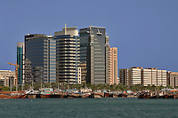 Dubai, United Arab Emirates. Dubai Creek and commercial waterfront offices, hotels, etc., behind the dhow mooring area. .