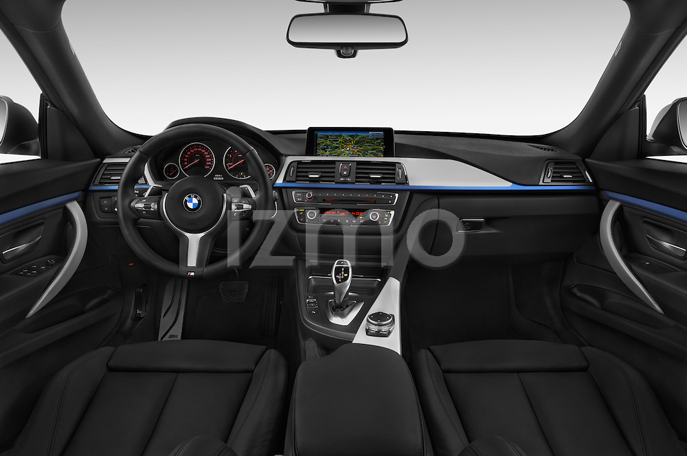 Stock photo of straight dashboard view of a 2015 BMW 3 Series M Sport 5 Door Hatchback 2WD Dashboard