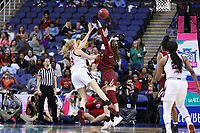 GREENSBORO, NC - MARCH 07: Elissa Cunane #33 of North Carolina State University shoots the ball over Emma Guy #11 of Boston College during a game between Boston College and NC State at Greensboro Coliseum on March 07, 2020 in Greensboro, North Carolina.