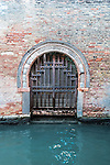 Door on the canal in Venice, Italy