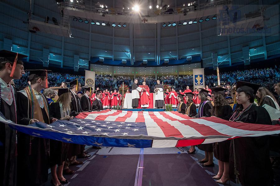 May 14, 2016; President Rev. John I. Jenkins C.S.C. blesses the flag at the 2016 Commencement Mass. (Photo by Matt Cashore/University of Notre Dame)