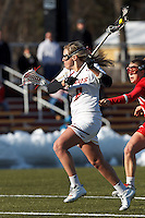 Boston College attacker Covie Stanwick (8) shoots the ball. .Boston College (white) defeated Boston University (red), 12-9, on the Newton Campus Lacrosse Field at Boston College, on March 20, 2013.