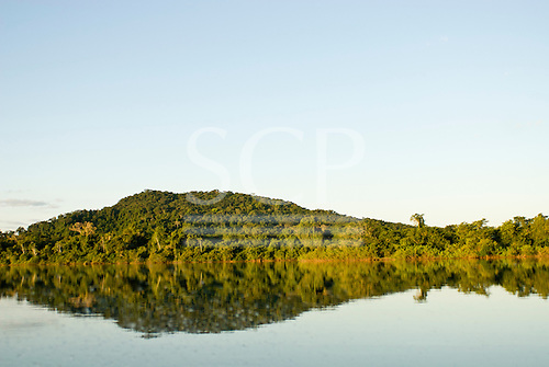 Pará State, Brazil. Xingu River. Forested island reflected in the river. Like a fish.