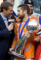 Houston Dynamo defender/captain (24) Wade Barrett is interviewed by ESPN commentator Rob Stone. The Houston Dynamo defeated the New England Revolution 2-1 in the finals of the MLS Cup at RFK Memorial Stadium in Washington, D. C., on November 18, 2007.
