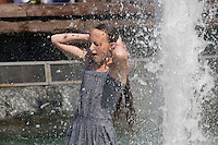 Moscow, Russia, 25/06/2010..A teenage girl in fountains next to the Kremlin and Red Square during a heatwave that has seen temperatures of up to 37C, a record for the month of June.