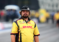 Jun 19, 2015; Bristol, TN, USA; Matt Bynum crew member for NHRA funny car driver Del Worsham (not pictured) during qualifying for the Thunder Valley Nationals at Bristol Dragway. Mandatory Credit: Mark J. Rebilas-