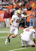 Boston College Eagles kicker Nate Freese (85) attempts a kick as Mike Marscovetra (16) holds during a game against the Syracuse Orange at the Carrier Dome on November 30, 2013 in Syracuse, New York.  Syracuse defeated Boston College 34-31.  (Copyright Mike Janes Photography)