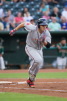 Nick Longhi (21) of the Greenville Drive hustles down the first base line against the Greensboro Grasshoppers at NewBridge Bank Park on August 17, 2015 in Greensboro, North Carolina.  The Drive defeated the Grasshoppers 5-4 in 13 innings.  (Brian Westerholt/Four Seam Images)