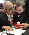 Nevada Sen. Majority Leader Mo Denis, D-Las Vegas, plays with his grandson Anderson Gale, 14-months, during the opening day of the 77th Legislative Session in Carson City, Nev. on Monday, Feb. 4, 2013. (AP Photo/Cathleen Allison)
