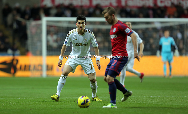 Sunday, 28 November 2012<br /> Pictured: Ki Sung-Yueng (L) and James Morrison (R).<br /> Re: Barclays Premier League, Swansea City FC v West Bromwich Albion at the Liberty Stadium, south Wales.