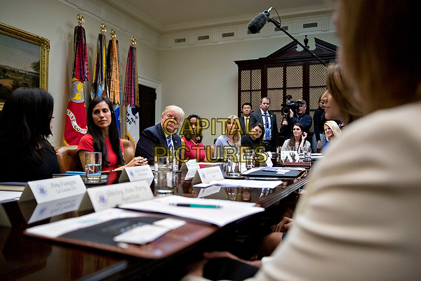 U.S. President Donald Trump, third left, and Ivanka Trump, daughter of Trump, center, listen during a meeting with women small business owners in the Roosevelt Room of the White House in Washington, D.C., U.S., on Monday, March 27, 2017.  Investors on Monday further unwound trades initiated in November resting on the idea that the election of Trump and a Republican Congress meant smooth passage of an agenda that featured business-friendly tax cuts and regulatory changes. <br /> CAP/MPI/CNP/RS<br /> ©RS/CNP/MPI/Capital Pictures