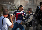 Israeli Border police officer arrests a Palestinian youth outside Damascus gate in Jerusalem Wednesday May 28 2014, during festivities marking Jerusalem day. The Day marks the reunification of Jerusalem following the 1967 Six Day War when Israel captured the Arab part of the city from Jordan. Photo By Eyal Warshavsky