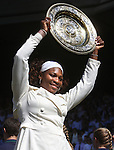July 4, 2009.Serena Williams poses with trophy after defeating her sister, Venus 7-6, 6-2 in the final of the Wimbledon Championships at the All England Lawn Tennis Club, Wimbledon, England