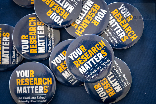 """August 4, 2020; Buttons with the Graduate School slogan """"Your Research Matters"""" at the 2020 Grad School orientation student resource fair (Photo by Matt Cashore/University of Notre Dame)"""
