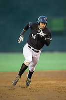Antonio Rodriguez (14) of the Kannapolis Intimidators follows through legs out a triple against the Augusta GreenJackets at Kannapolis Intimidators Stadium on May 3, 2017 in Kannapolis, North Carolina.  (Brian Westerholt/Four Seam Images)