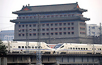 High-speed rail passes in front of the ancient tower of Beijing City Wall, Beijing, China. China is the first and only country to have commercial high-speed train service on conventional rail lines that can reach a top operational speed of 350 km/h (217 mph)..30 Aug 2010