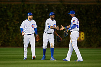 Chicago Cubs outfielders Ben Zobrist (18), Dexter Fowler (24), and Jason Heyward (22) celebrate closing out Game 5 of the Major League Baseball World Series against the Cleveland Indians on October 30, 2016 at Wrigley Field in Chicago, Illinois.  (Mike Janes/Four Seam Images)